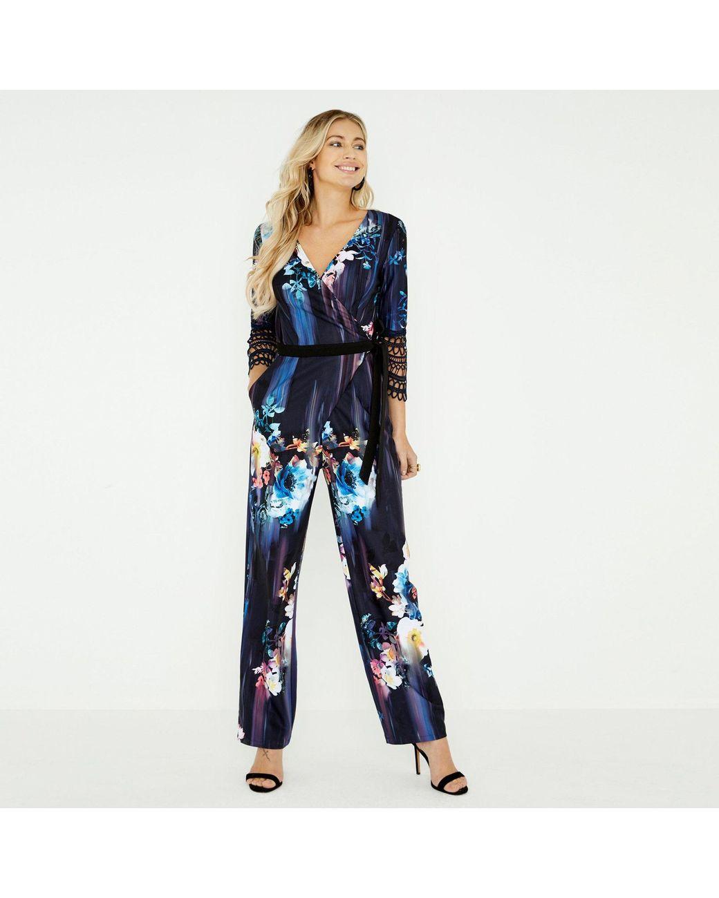 b84ca78355 Little Mistress Navy Viola Floral Mock Wrap Jumpsuit in Blue - Lyst