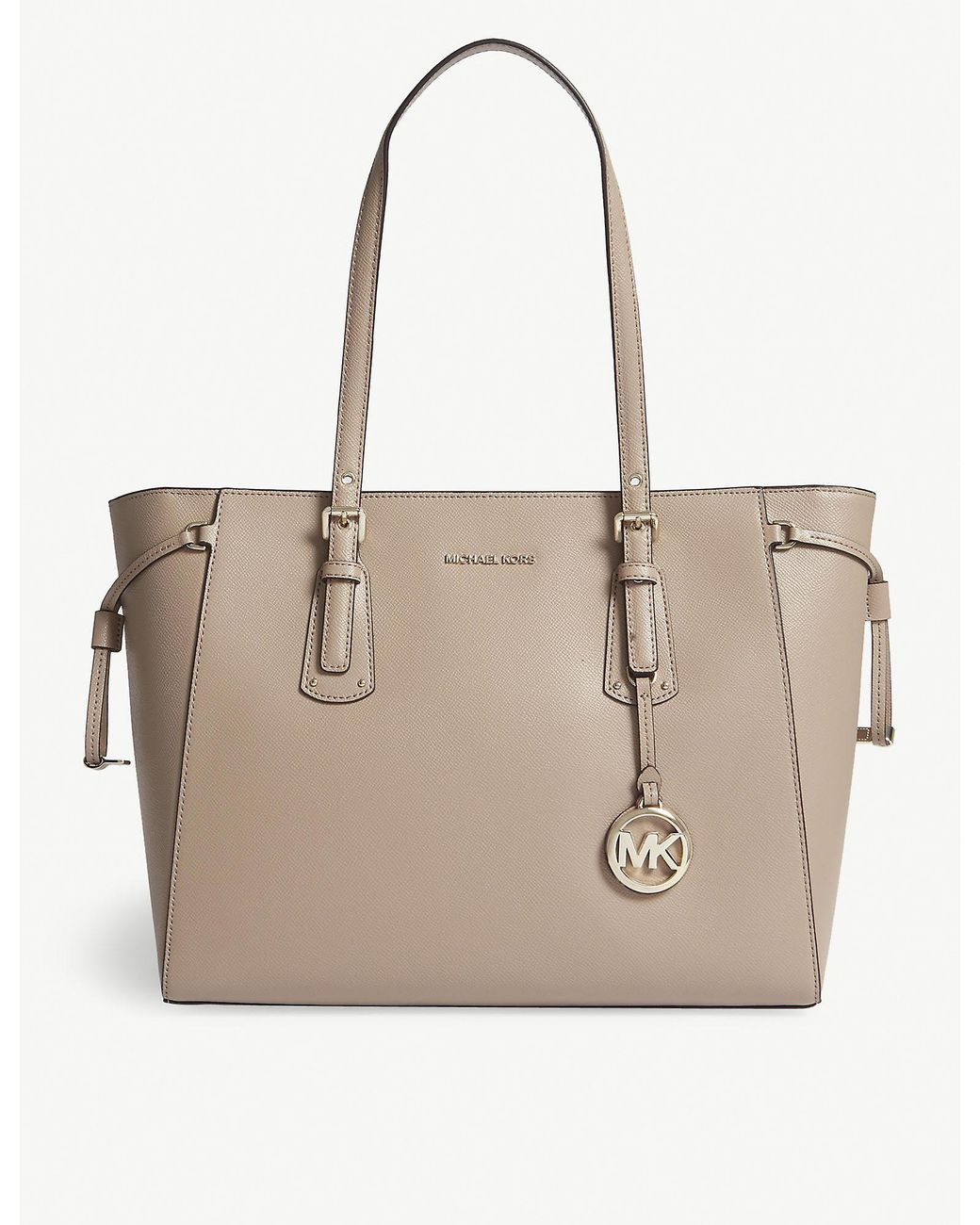 e21d5022c9b024 MICHAEL Michael Kors Michael Kors Truffle Beige Voyager Leather Tote Bag in  Natural - Lyst