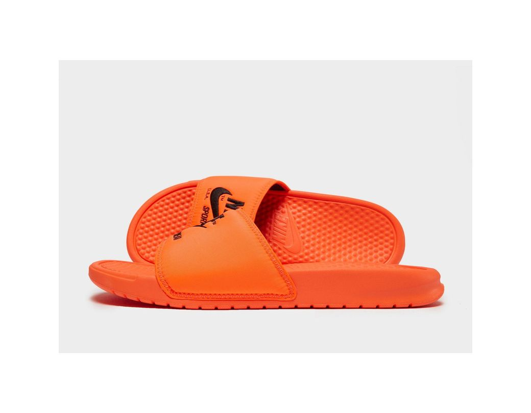 38c3136f55b1 Lyst - Nike Sportswear Benassi Text Slides in Orange for Men