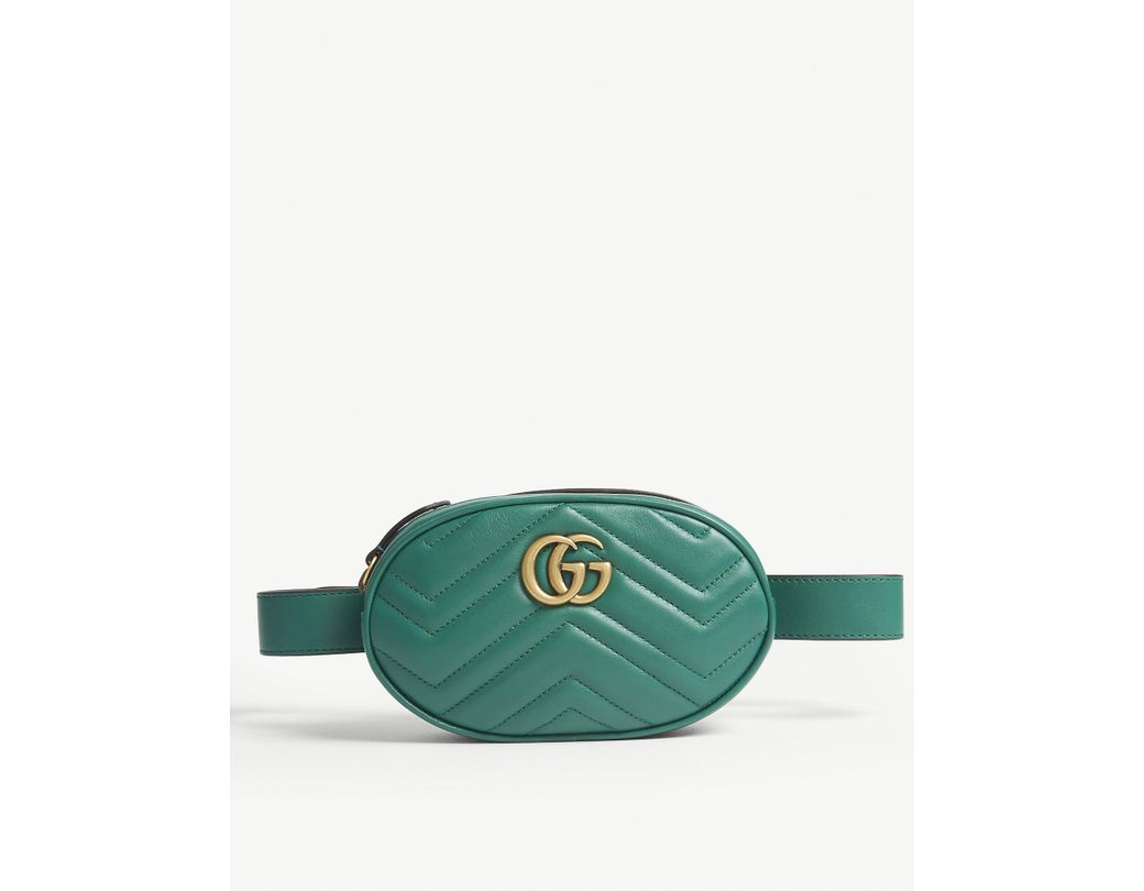 fddc0430e04c Lyst - Gucci Marmont Quilted Leather Belt Bag in Green