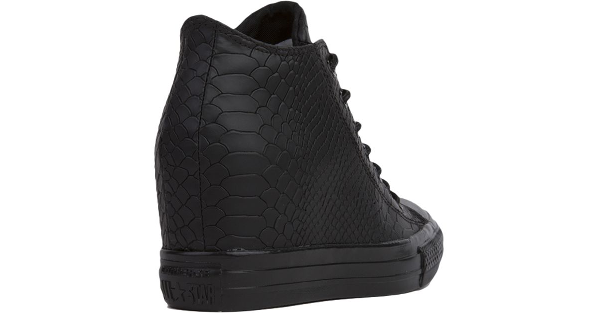 a375d3d7c8e7 Lyst - Converse Chuck Taylor All Star Lux Embossed Reptile Mid Top Sneaker  Wedges - Black in Black