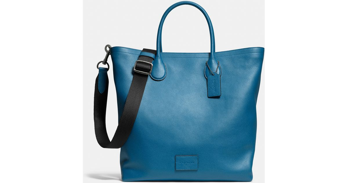 7179236ad610 Lyst - COACH Mercer Tote In Pebble Leather in Blue