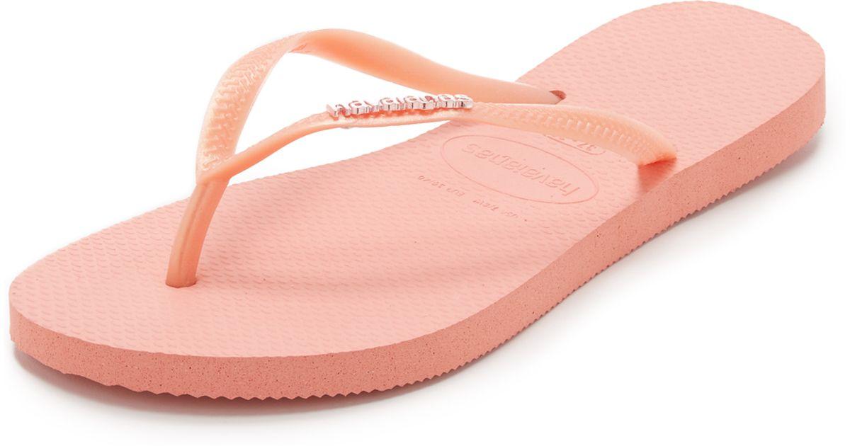 41476818c42010 Lyst - Havaianas Slim Logo Metallic Flip Flops in Pink