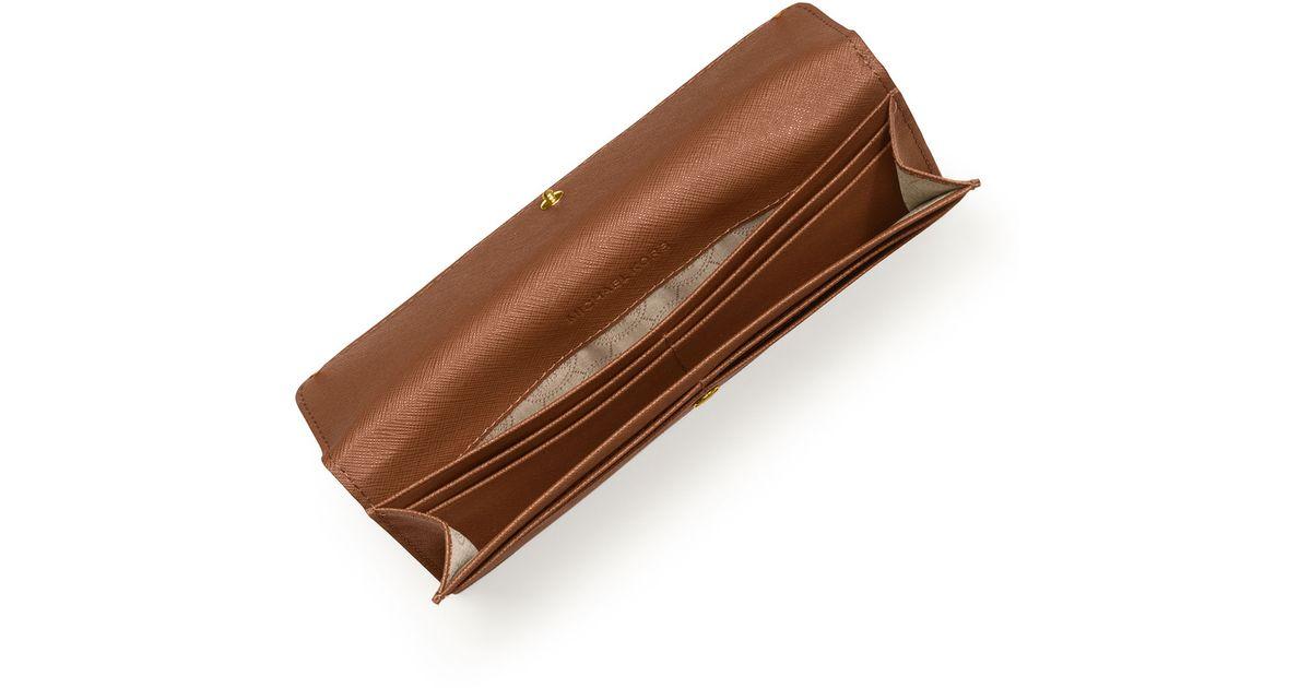 827587d45e62 MICHAEL Michael Kors Jet Set Travel Flat Wallet in Brown - Lyst