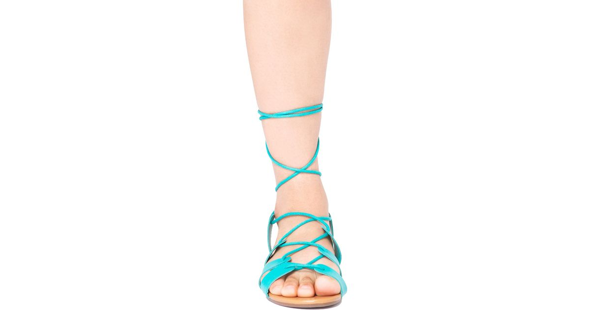 239895221 AKIRA Strappy Lace Up Aqua Blue Flat Sandals in Blue - Lyst