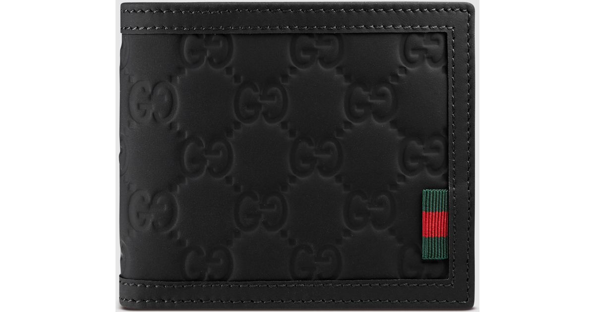56bc75c31f0 Lyst - Gucci Rubber Ssima Leather Bi-fold Wallet in Black for Men
