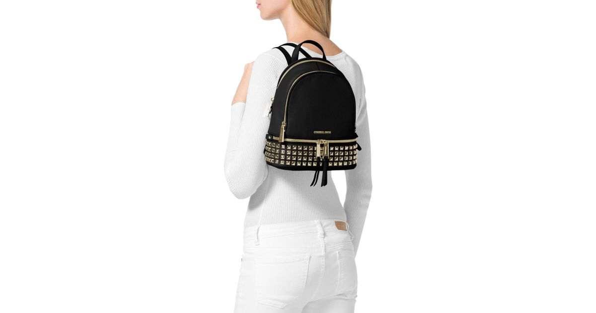 5ea747b38cdc Lyst - MICHAEL Michael Kors Extra Small Rhea Zip Studded Backpack in Black