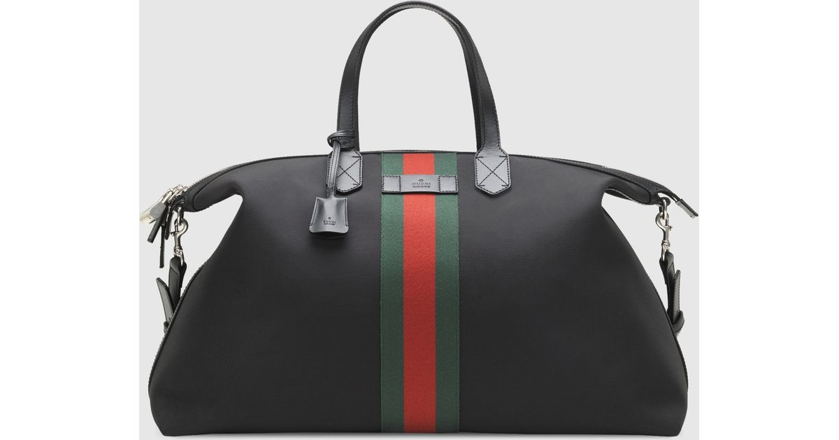 a15d7e3ebb2 Lyst - Gucci Techno Canvas Duffle Carry-on Bag in Black for Men