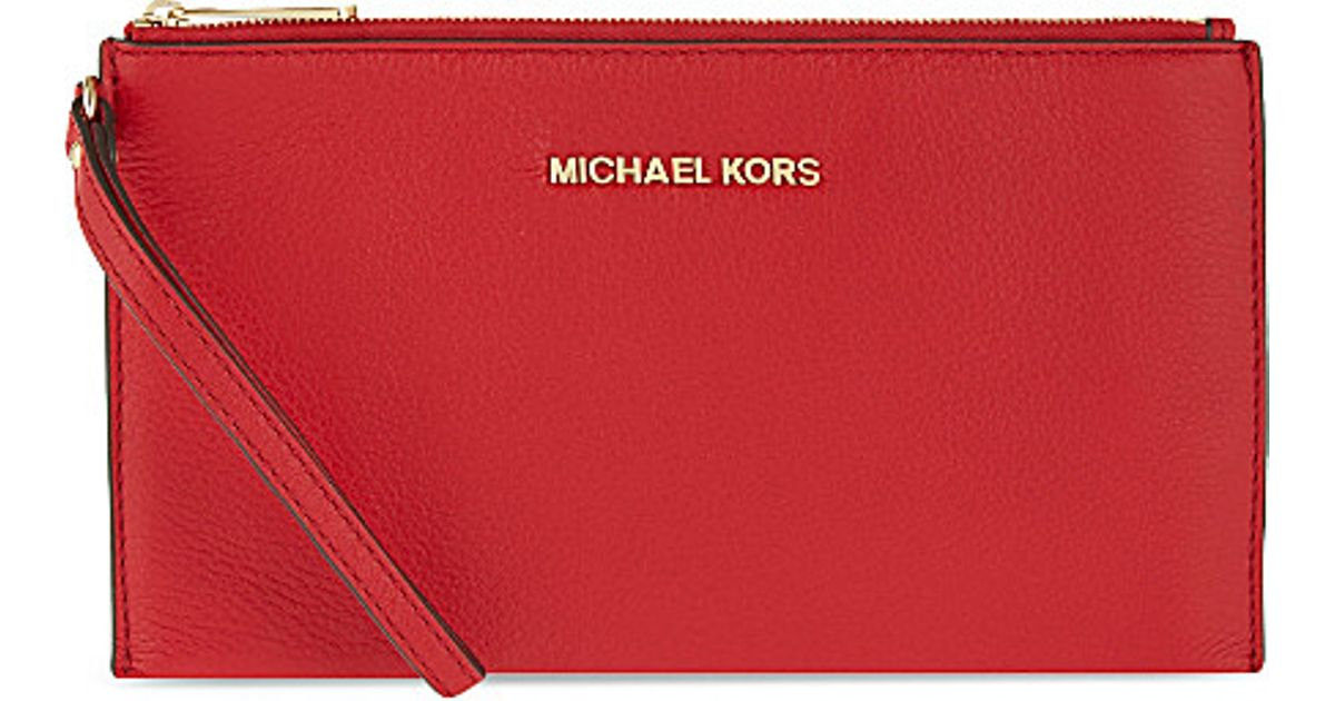 9876c4571ede ... cheapest michael michael kors bedford large leather clutch bag for  women in red lyst 49644 b35ef ...