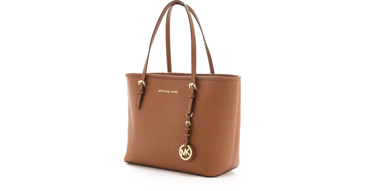 d2dc3bc23cb8 ... order lyst michael michael kors small jet set travel tote luggage in  brown 0be8b e636e ...
