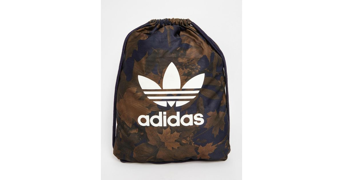 Lyst - adidas Originals Drawstring Backpack In Camo Ax6315 in Green for Men dd5d5898eb