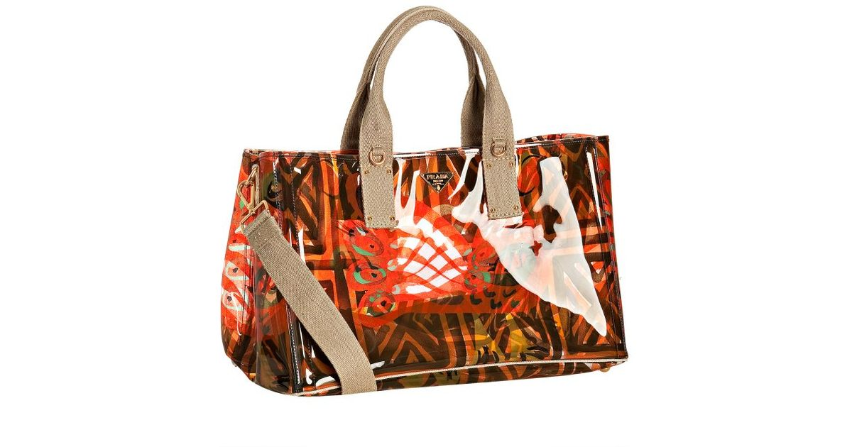 1d72a35082b2bb ... bag d32c8 37d39 reduced prada red tribal clear printed pvc tote in red  lyst 4fb83 aeaaf ...