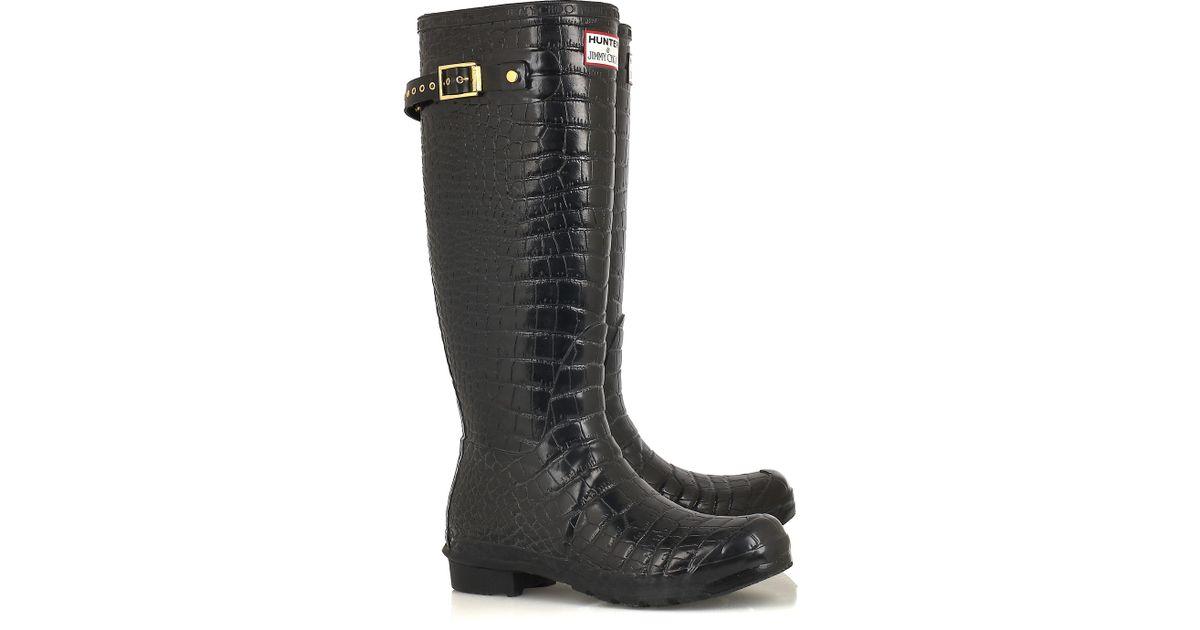bc9829345c1 ... sale lyst jimmy choo crocodile print wellington boots in black 5df7e  3ecd8