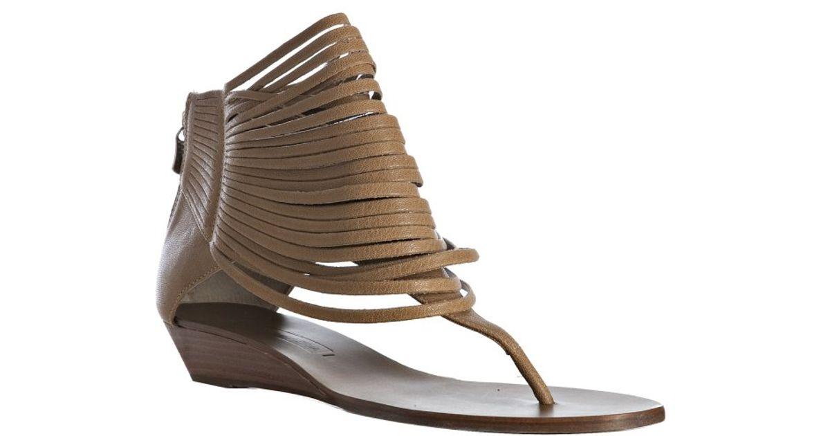 3d0da464d91d1 Lyst - Bcbgmaxazria Doe Leather Irmah Strappy Thong Flat Sandals in Brown