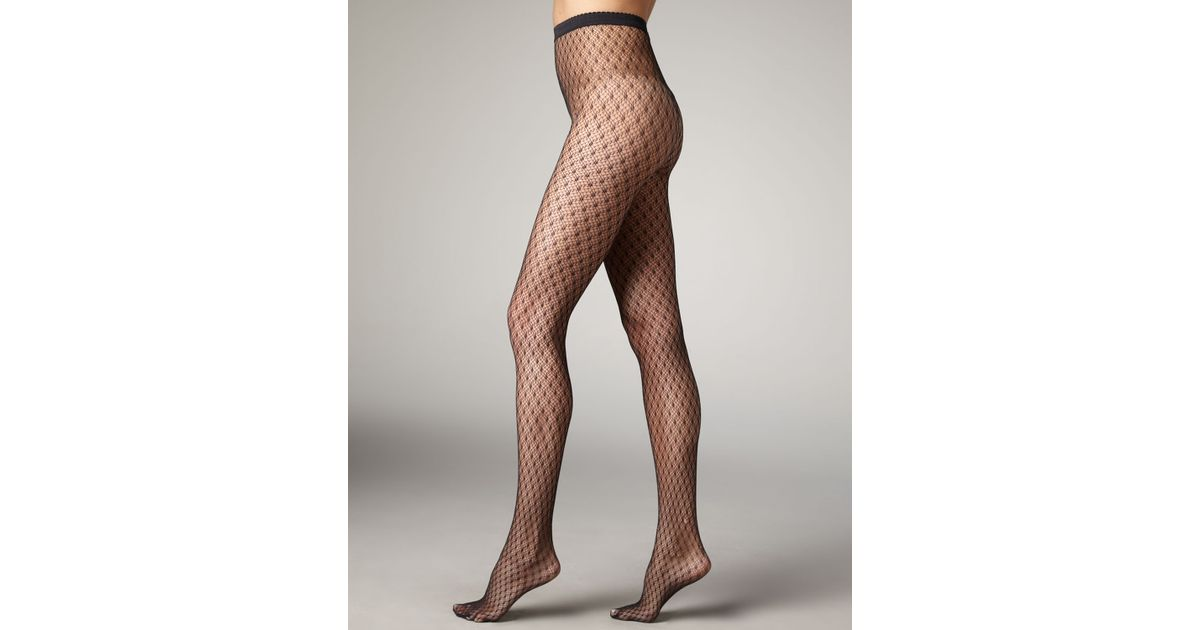 4765e72222d07 Wolford Clara Dot Fishnet Tights in Black - Lyst