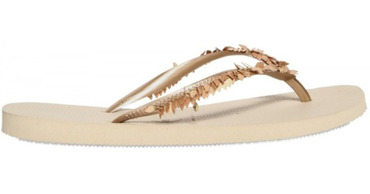 ef0bae5a7959 Lyst - Havaianas Metallic Leaves Flip Flop Flats in Natural