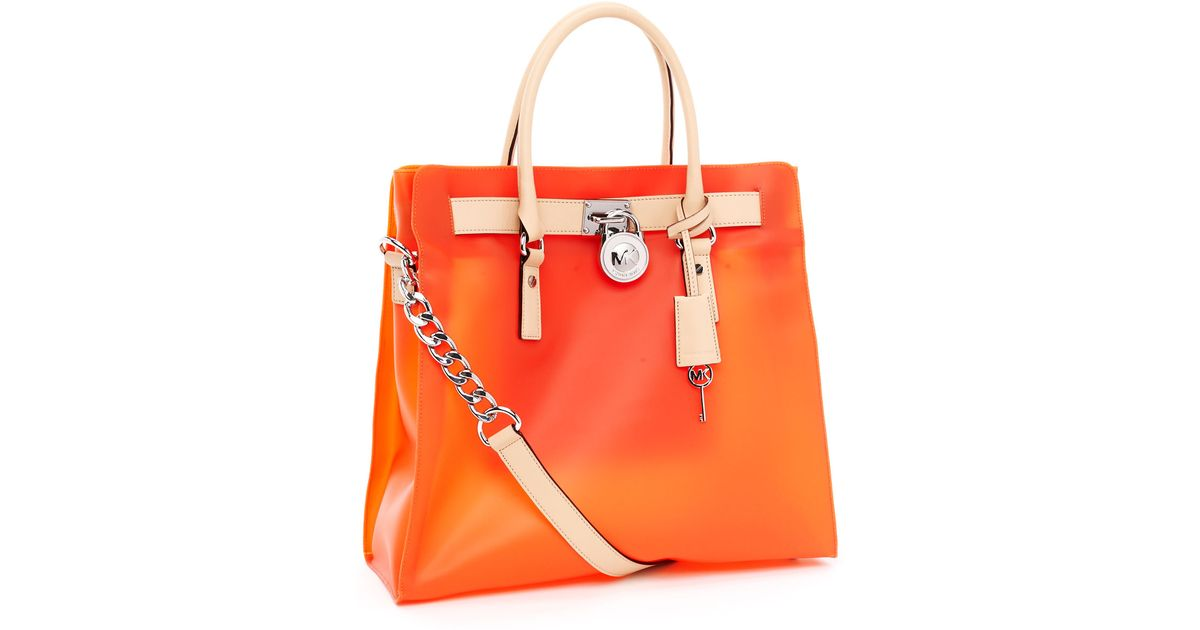 6069d7897f4ff Lyst - MICHAEL Michael Kors Large Hamilton Frosted Jelly Tote in Orange