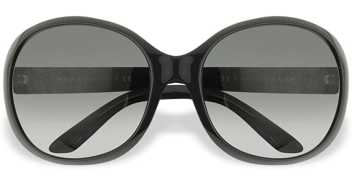 caecd09a5433 wholesale prada round brow bar sunglasses black. prada 7838b 043b7;  official lyst prada round plastic sunglasses in black 97459 e5b9c