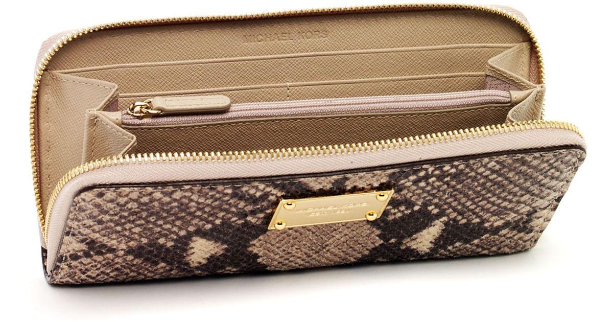 91f61041f8bc ... where to buy lyst michael michael kors jet set continental wallet dark  sand python de7d8 5ef34