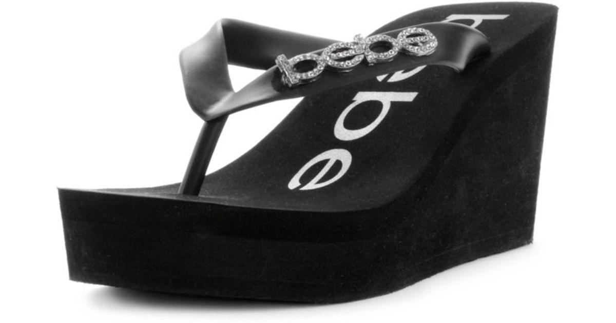 bebe kristy wedge flip flop sandals in black lyst