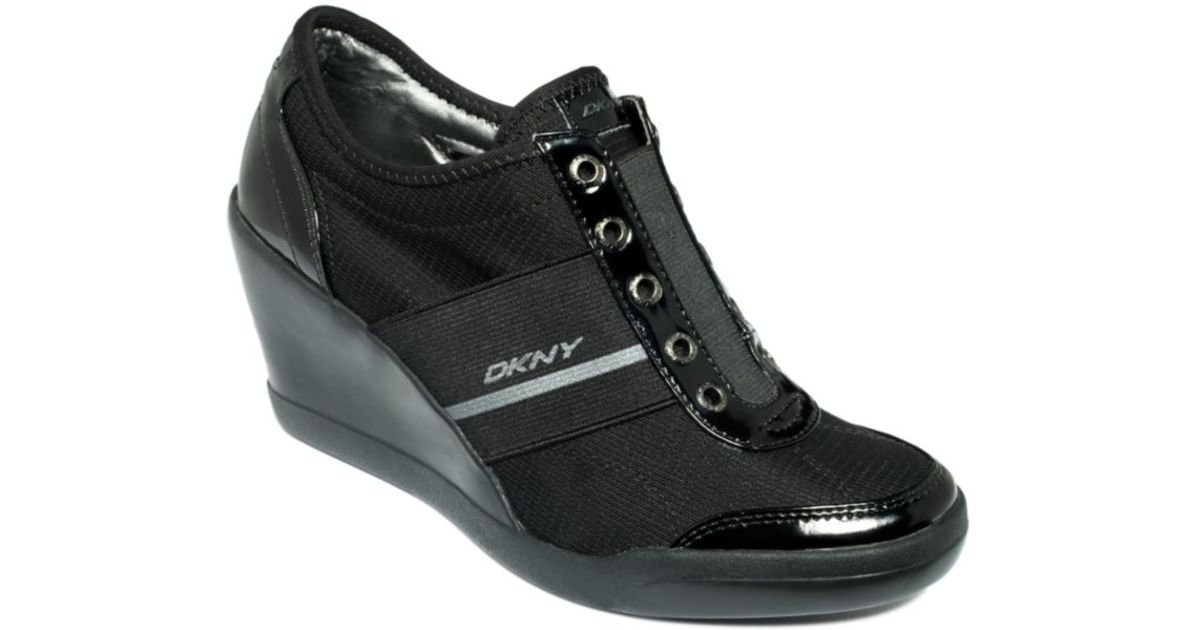 b20fa660621 Lyst - DKNY Darcy Wedge Sneakers in Black