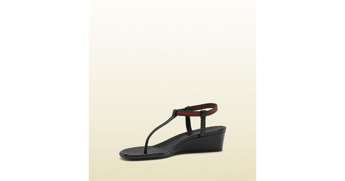 ed827355c Gucci Areia Wedge Low Heel Wedge Thong with Signature Web Ankle Strap in  Black - Lyst