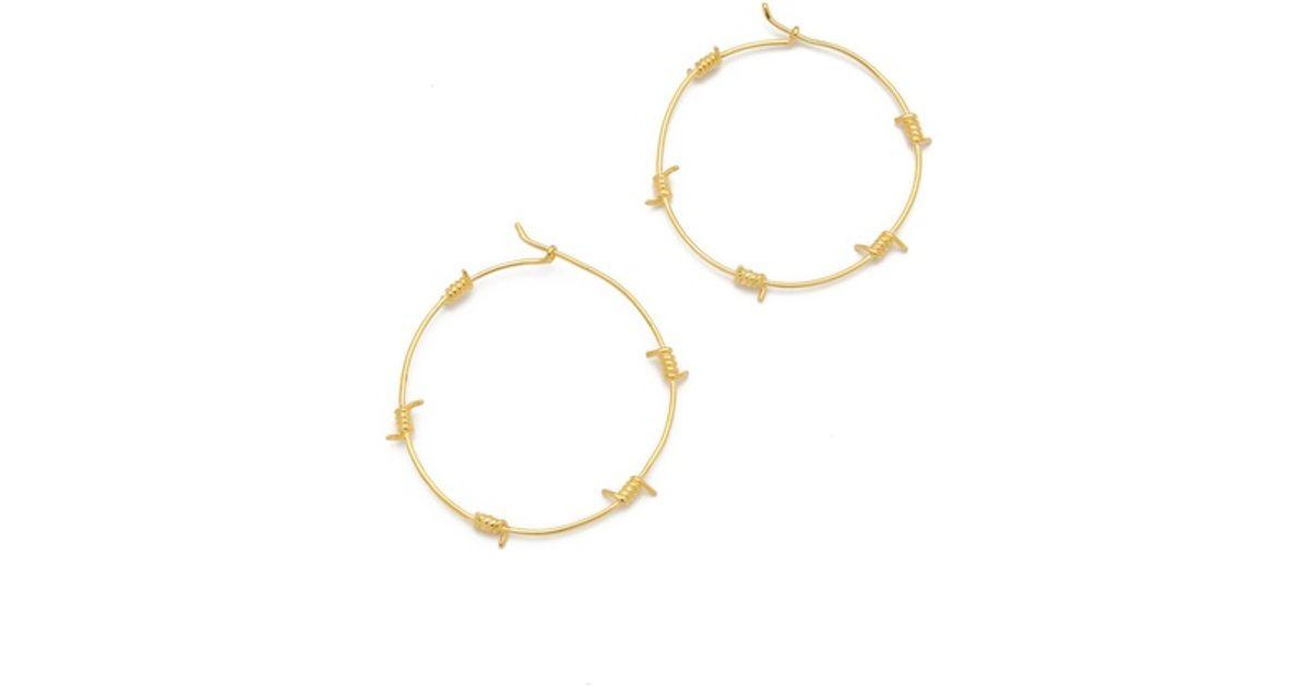 Lyst Tom Binns Barricade Babe Barb Wire Hoop Earrings In Metallic