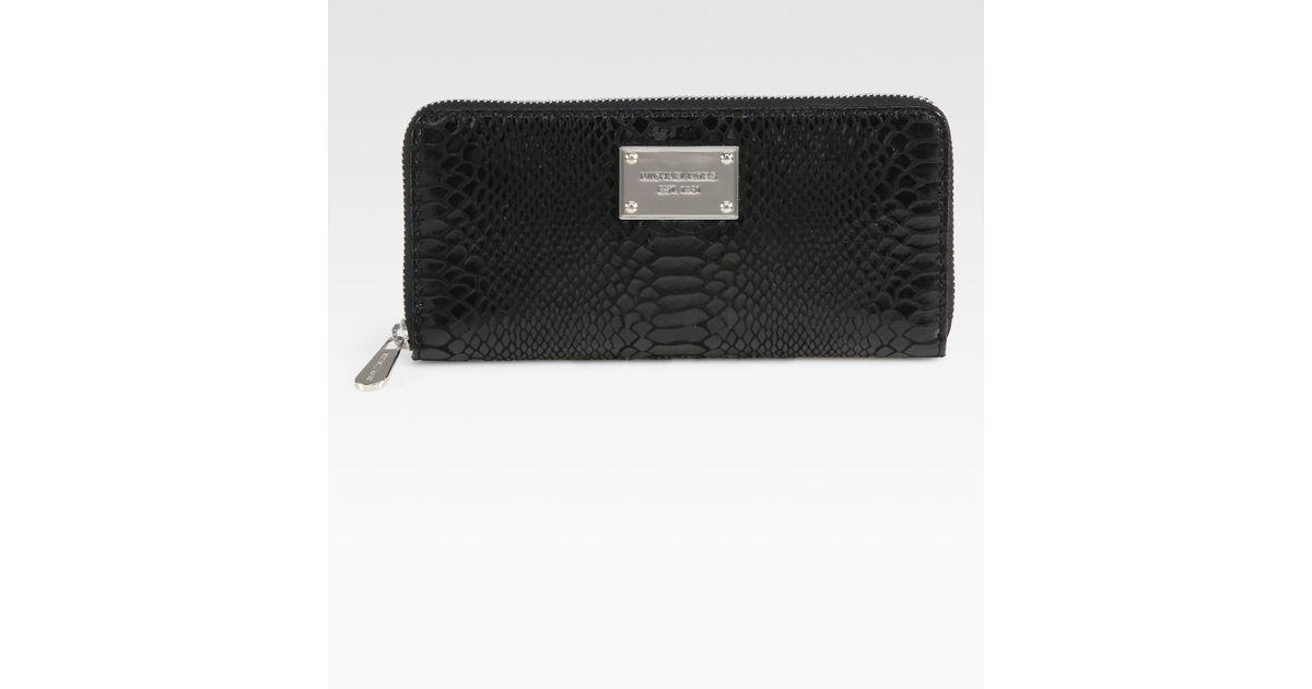 ee4e884f0bd2 Lyst - MICHAEL Michael Kors Snake Embossed Leather Zip Around Wallet in  Black