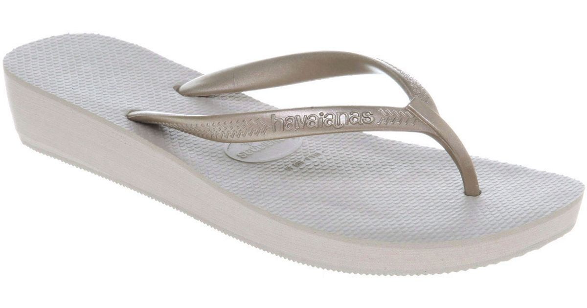 f1393d6a81ec18 Lyst - Havaianas Highlight Wedge Flip Flop Gold Rubber in Gray