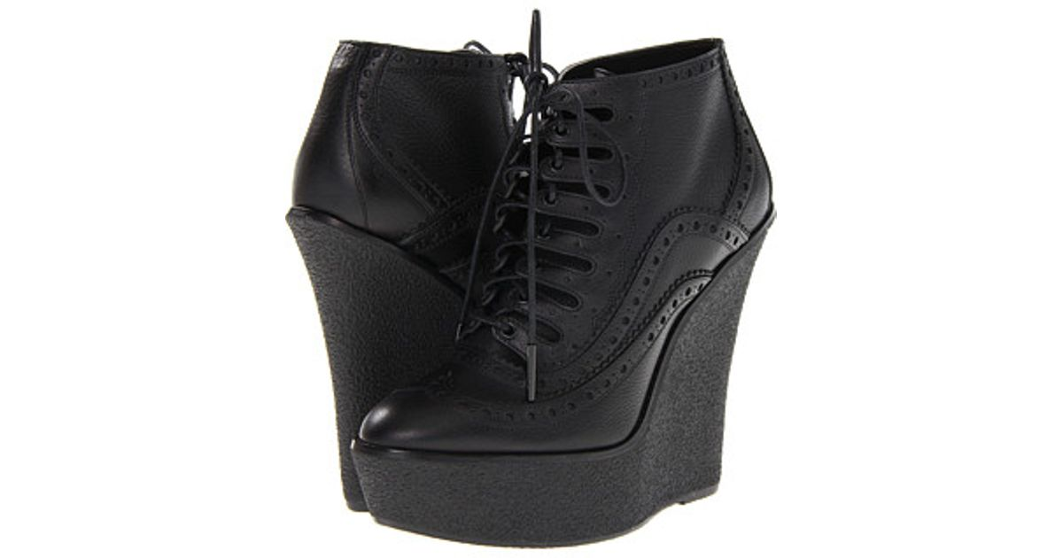 65f40c177d76 Lyst - Burberry Brogue Leather Wedge Ankle Boots in Black