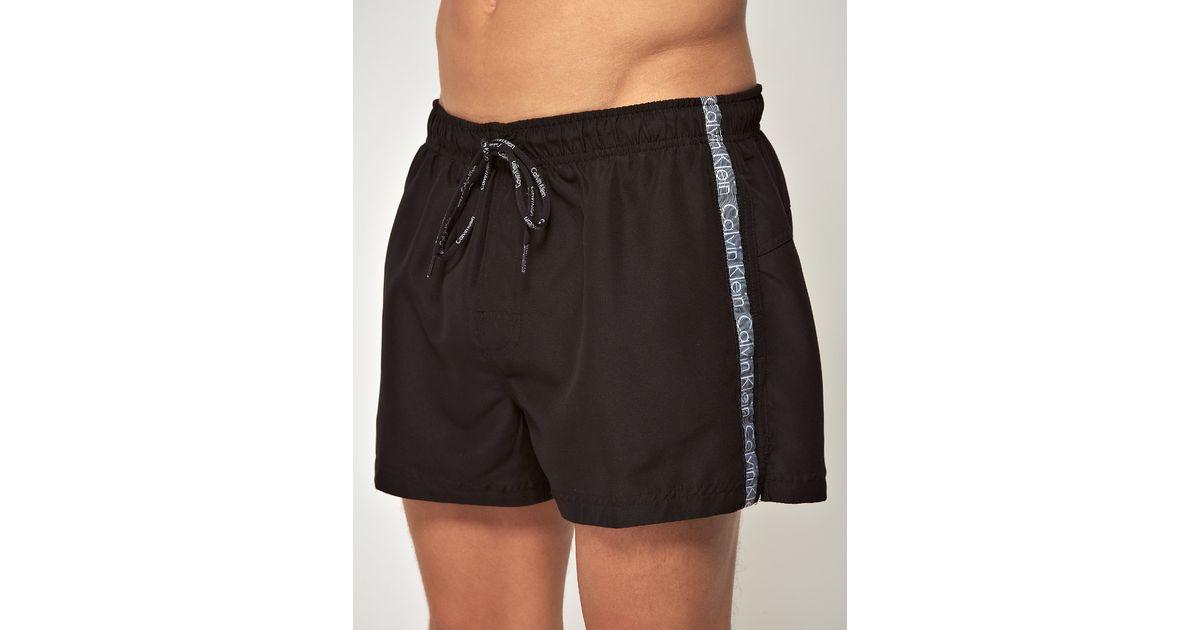 b46c795151644 Calvin Klein Logo Tape Swim Shorts in Black for Men - Lyst