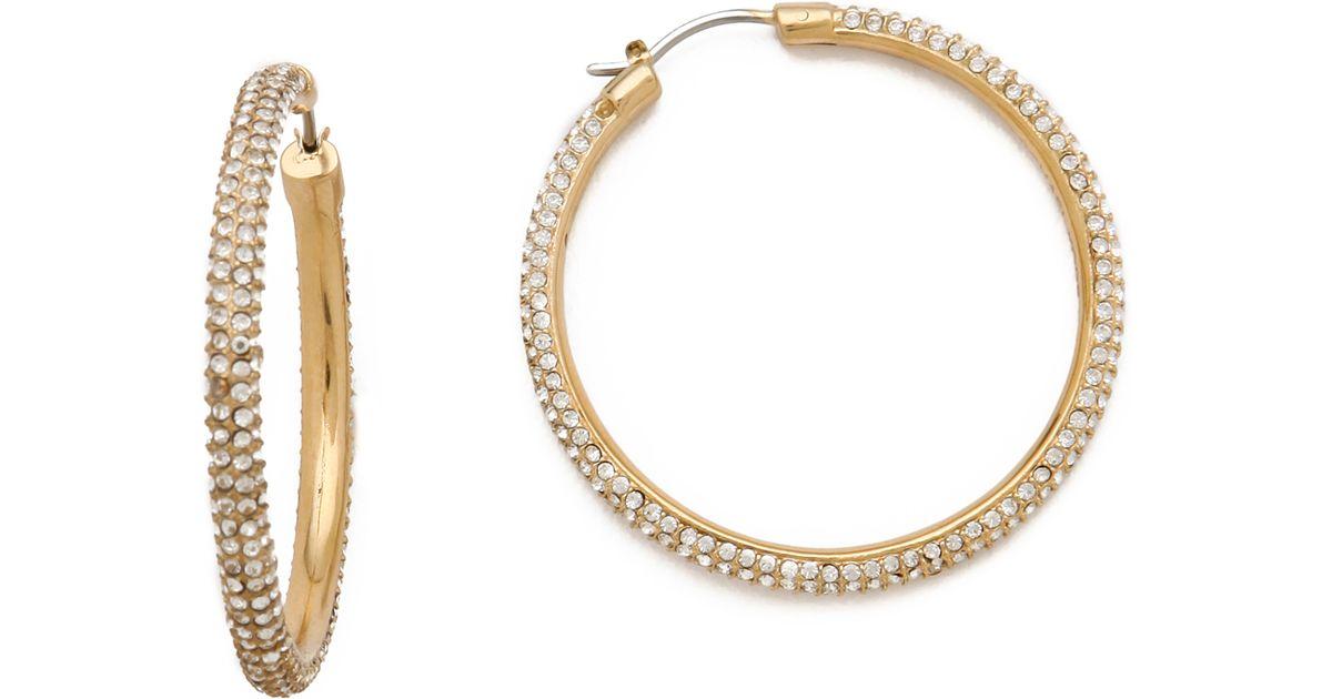 58c335a7b8cc2 Lyst - Michael Kors Pave Hoop Earrings in Metallic