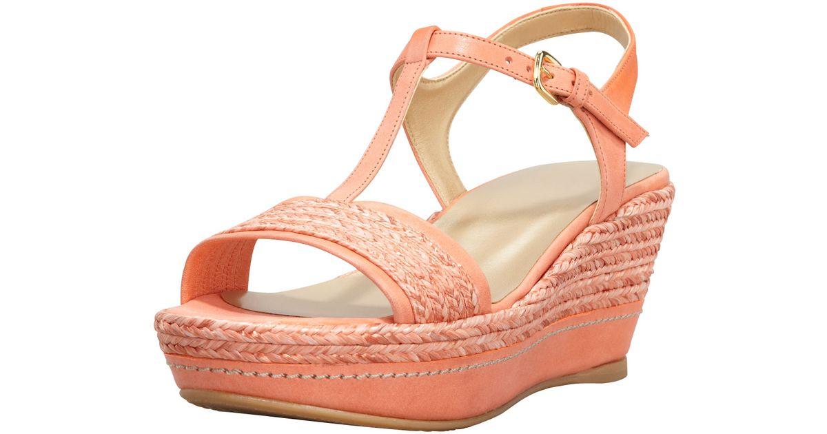 da89a4f178d5 Lyst - Stuart Weitzman Flatty Raffia Braided Wedge Sandal Peach in Orange