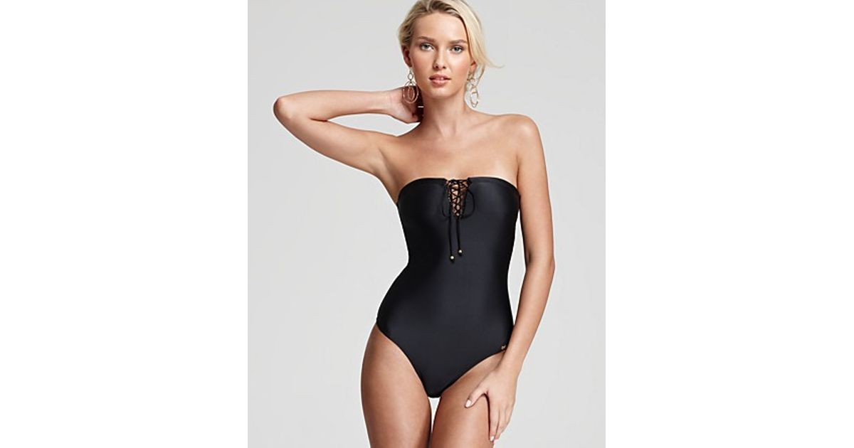 6723cc80179b9 Pilyq Resort Black One Piece Bandeau Lace Up Swimsuit in Black - Lyst