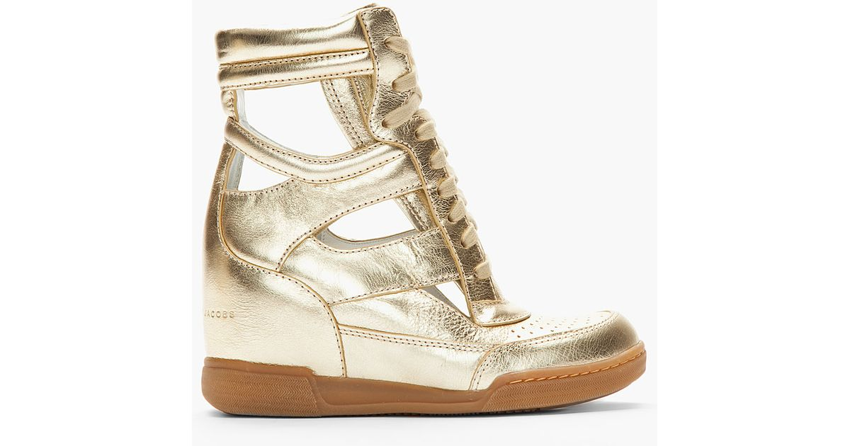 Lyst - Marc By Marc Jacobs Metallic Gold Leather Cutout Sneaker Wedges in  Metallic fc828b14f