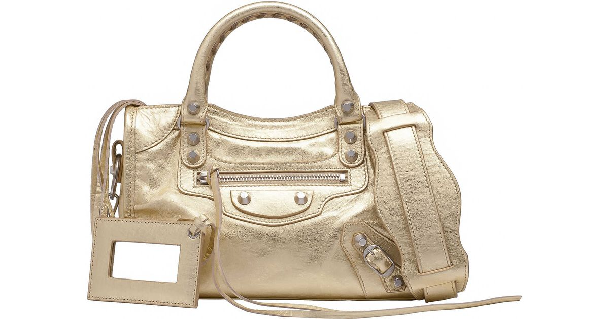 ccac3356f253 Lyst - Balenciaga Balenciaga Metallic Mini City Gold in Metallic