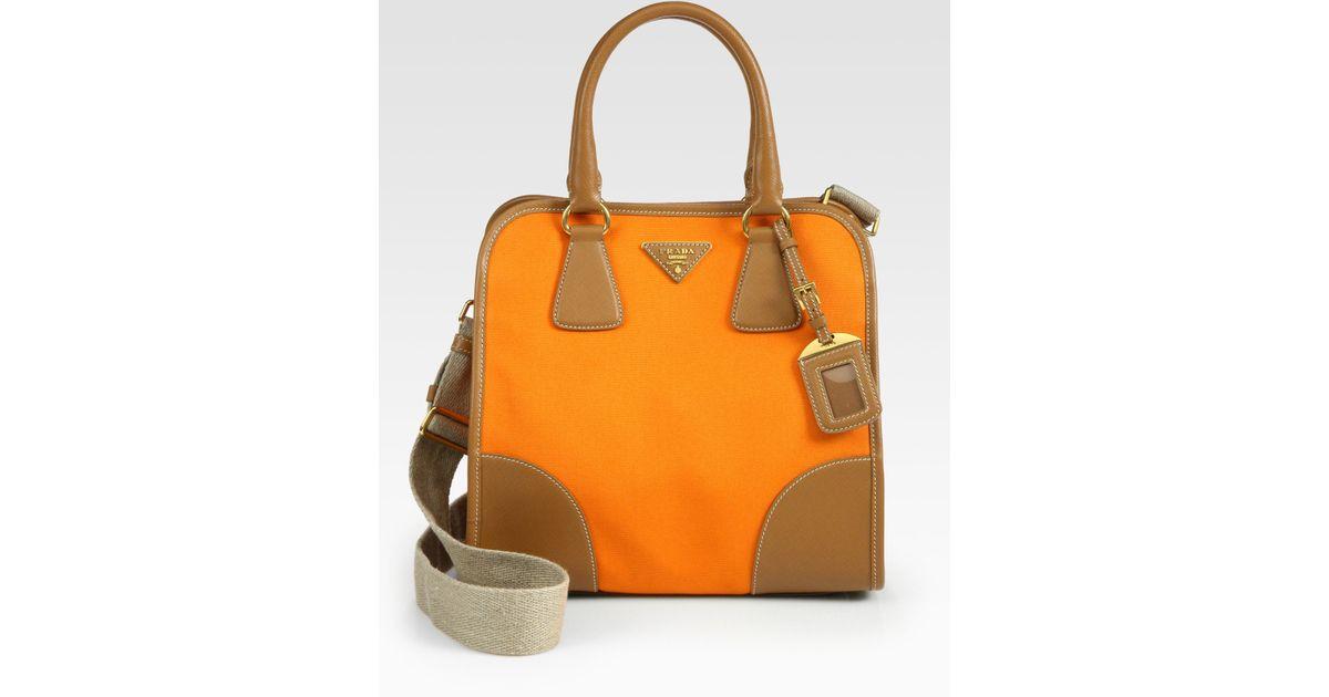 1020efb554e1e2 Prada Saffiano Leather Canvas Tote Bag in Orange - Lyst
