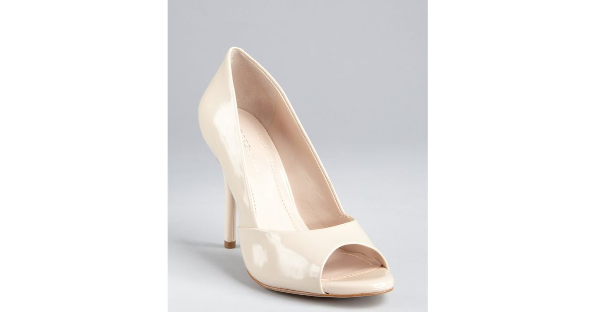 3bb5ba5adb7 Lyst - Bcbgeneration Nude Faux Patent Leather Peep Toe Izzie Pumps in  Natural