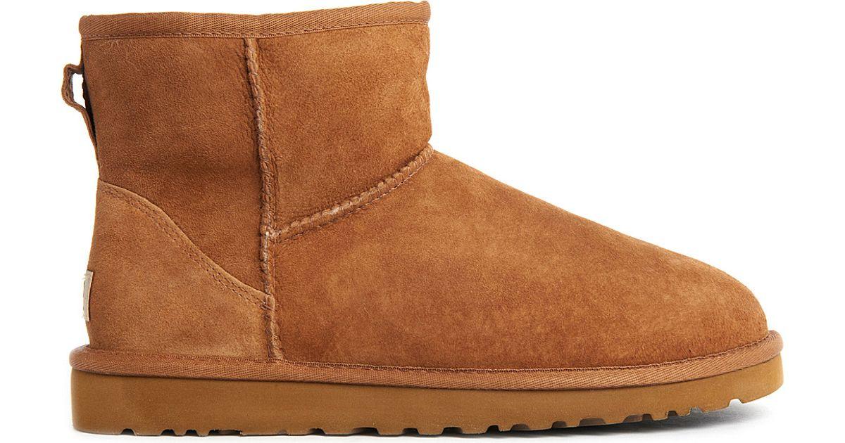 ugg classic mini sheepskin boots in brown lyst