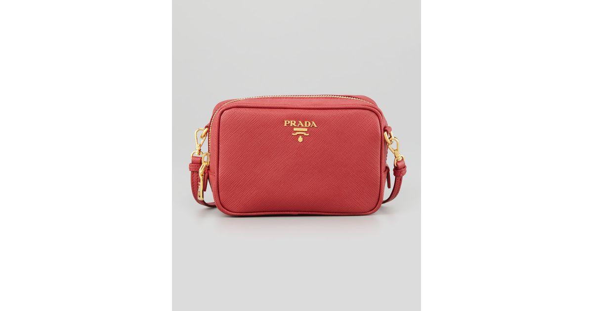 fef18f2b31f360 Prada Saffiano Mini Zip Crossbody Bag in Red - Lyst