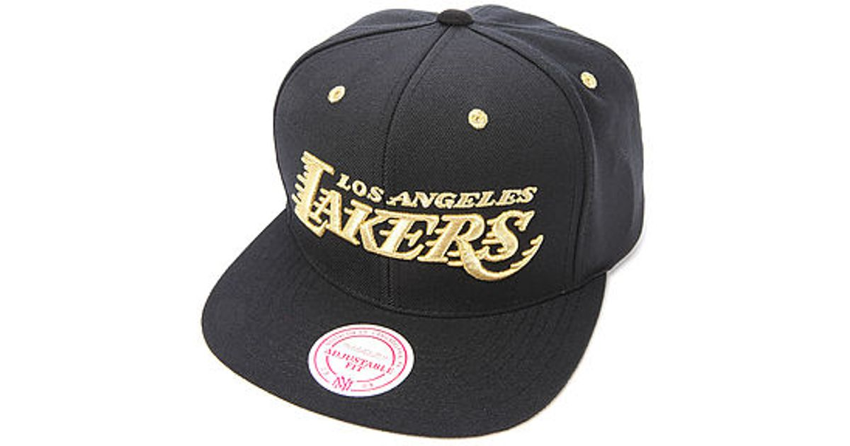 huge selection of d9177 9a2a7 ... promo code for lyst mitchell ness the los angeles lakers metallic snapback  cap in black for
