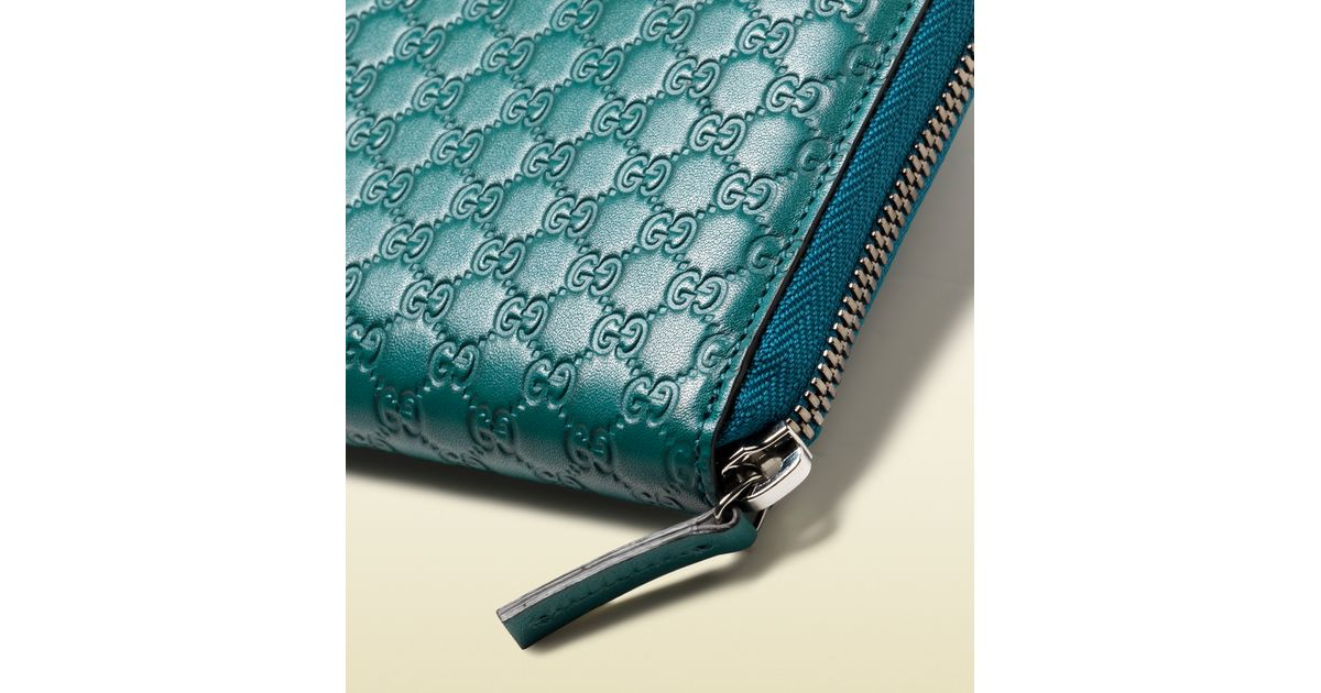 7a7dcaeeea81 Gucci Microguccissima Leather Zip Around Wallet in Blue for Men - Lyst