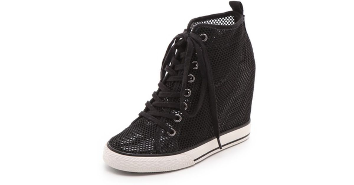 5c8f2d0b732a Lyst - DKNY Grommet Wedge Sneakers in Black