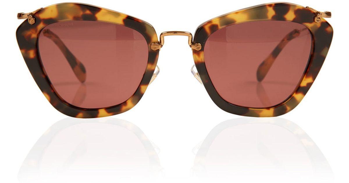 f8fe3f93ed1 Lyst - Miu Miu Tortoiseshell Noir Cat Eye Sunglasses