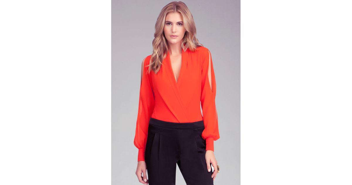 670f4a7c78e6 Bebe Long Sleeve Silk Wrap Bodysuit in Orange - Lyst