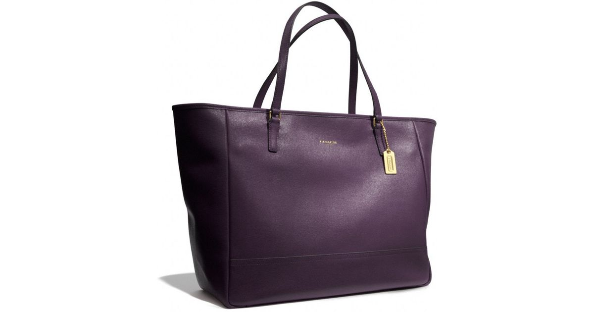 discount review coach city tote vs. michael by michael kors saffiano medium  travel tote elle blogs 5e07c 6ac38  get lyst coach large city tote in  saffiano ... cce5651ea8462