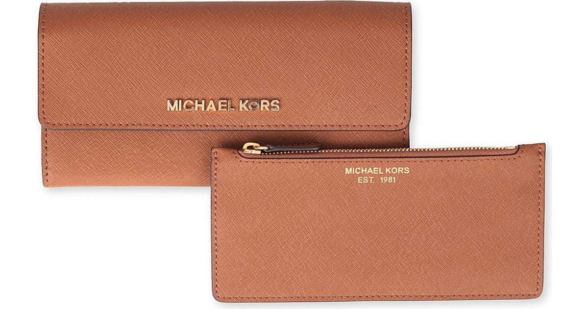 b72c32d69ec7f Michael Kors Michael Kors Saffiano Leather Trifold Wallet in Brown - Lyst