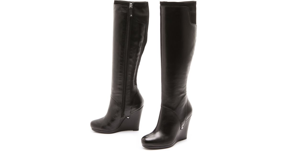 6a52d1b0493 Lyst - DKNY Nadia Stretch Back Wedge Boots in Black