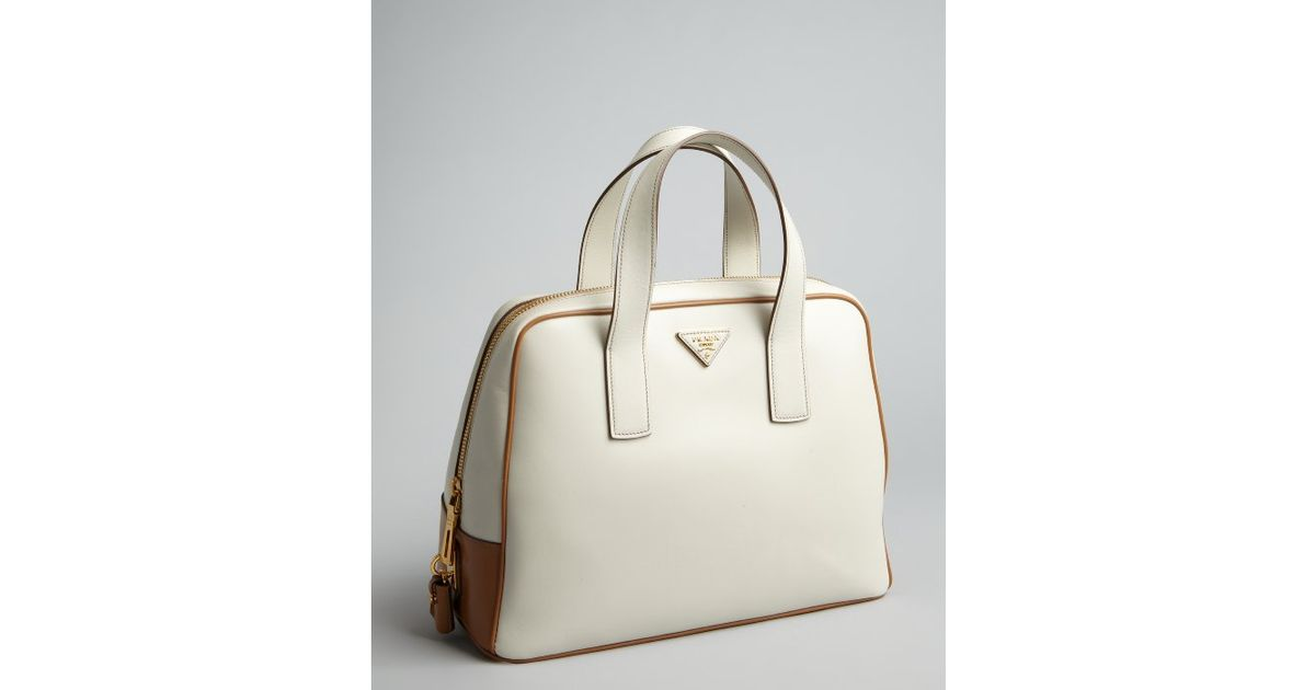 f8a6eb10f6 ... greece lyst prada cream and tan leather bowler bag in natural 58cab  586b7