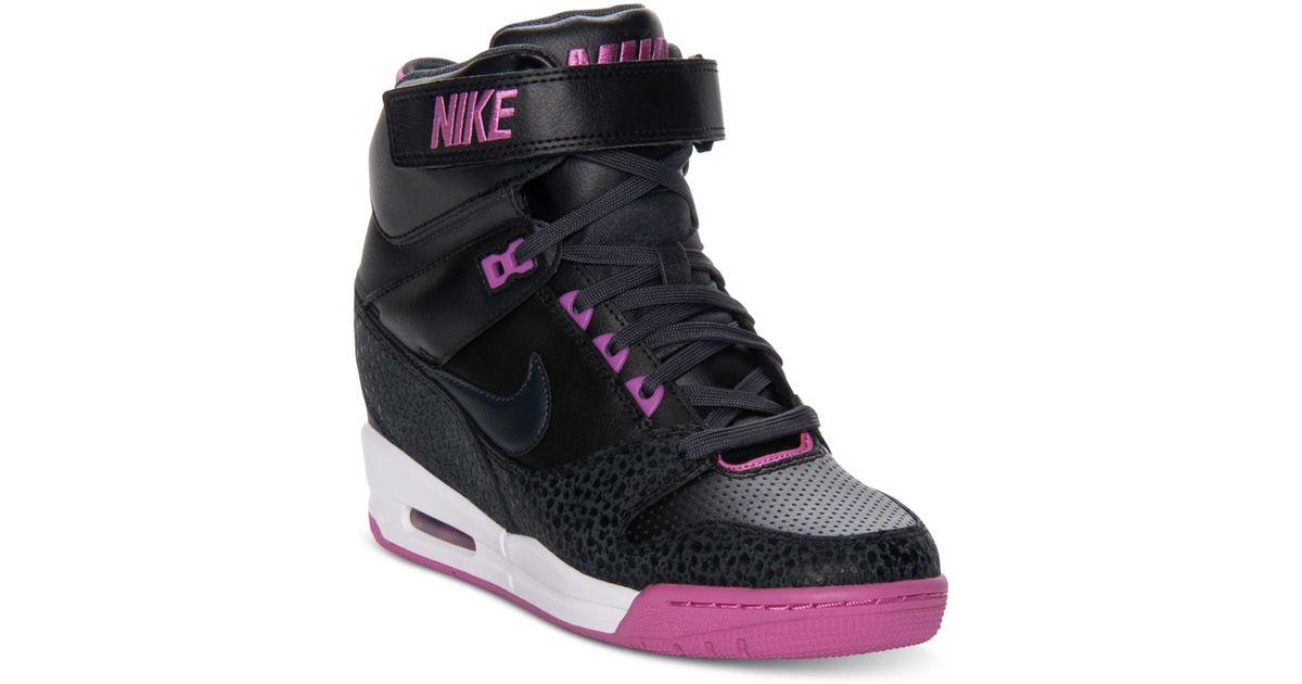 81793f53f2c Lyst - Nike Air Revolution Sky Hi Casual Wedge Sneakers in Black